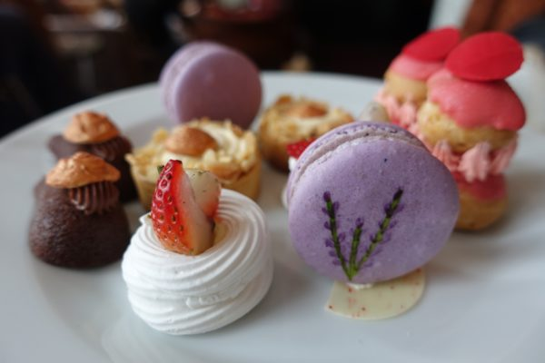 rose cream puffs, lavender macarons, strawberry meringue and chocolate delights